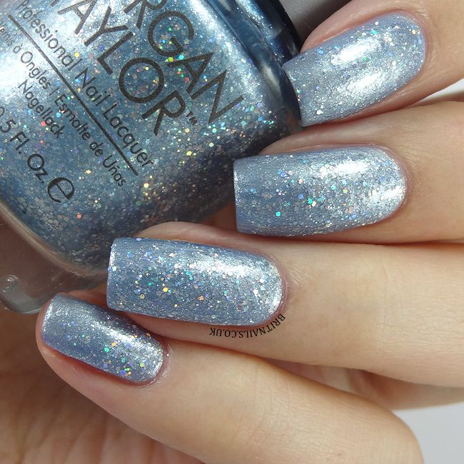 Morgan Taylor Cinderella Collection 'If The Slipper Fits' (Silver-blue glitter with holo particles) layered over 'Best Ballgown Ever' (Frosty blue with golden shimmer) ~ swatch by Brit Nails