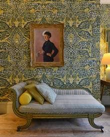KIpling Suite at Brown's Hotel by Olga Polizzi. the wallpaper, a dense pattern of exotic verdure designed by Flora Roberts for the Gloucestershire-based company Lewis & Wood, from which all the fabrics here have been sourced bar the pale ikat-like curtaining, which is Manuel Canovas. The bespoke furniture has been made by the Battersea furniture maker Julian Chichester. The antique plaster scallop-shell light fittings in the marble bathroom is from Porta Romana. ?Alhambra 50, £56.40 per m