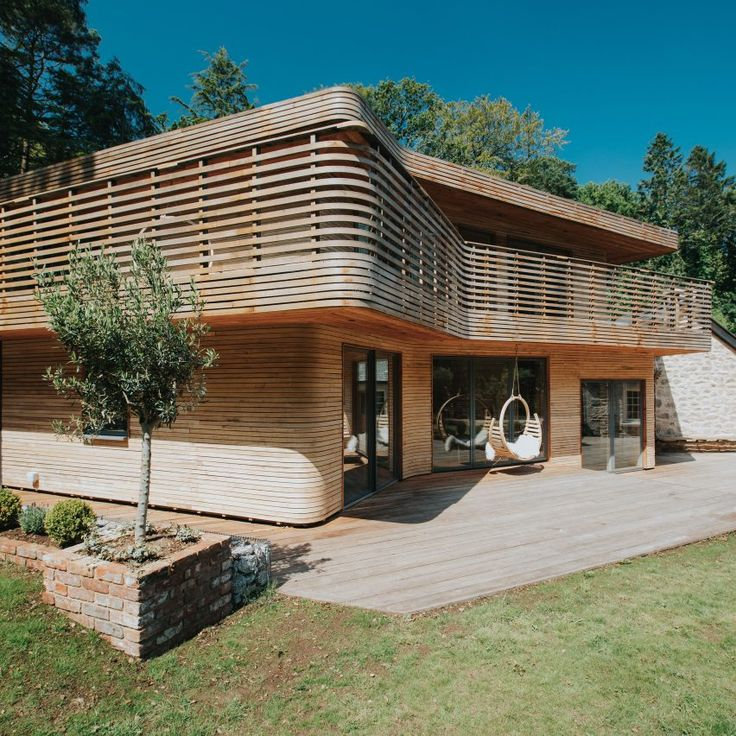 Based on techniques developed in their furniture design, Tom and Danielle Raffield used steam-bent timber – a traditional way of shaping timber using heat and moisture – to cover the extension to their home, which occupies an old gamekeeper's lodge.