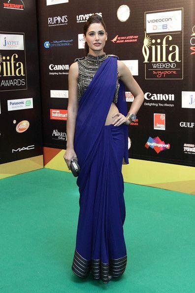 Nargis Fakhri wearing Annaika. Love the colour and the blouse .
