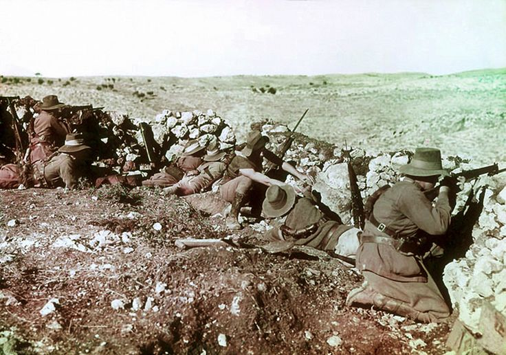 Soldiers of the 2nd Australian Light Horse Regiment behind the front line barricades at Nalin during the war against the Ottoman Empire, Palestine, 17th January, 1918 (colour Paget plate) by Frank Hurley, (1885-1962)