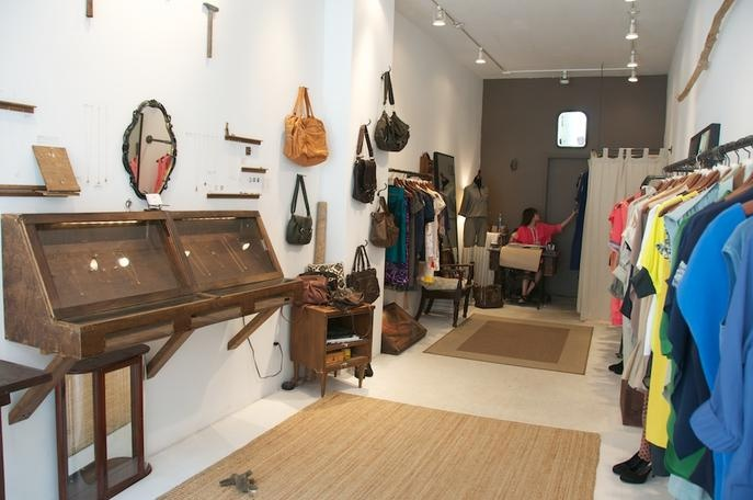 Inside the SZEKI store. 157 Rivington Street. NYC.   vintage jewelry cabinets and recycled galv pipe clothing racks