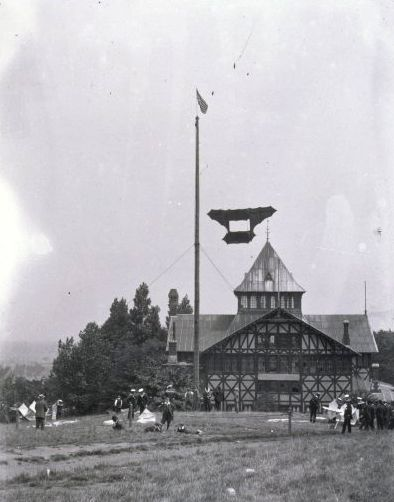 Blandford Hall. Until 1970, this building stood in Alexandra Palace Park. it was burned down by arsonists. also seen are Samuel Franklin Cody's man lifting kites, Ally Pally Park