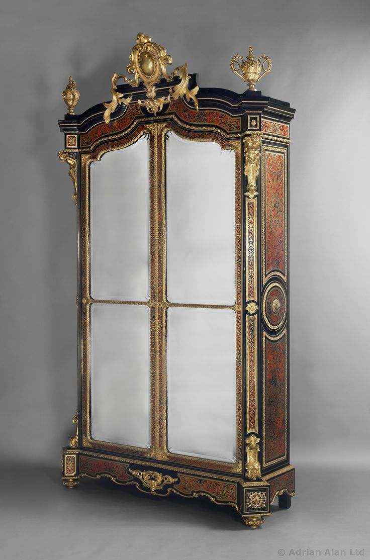 A Magnificent and Important Napoléon III Gilt-Bronze-Mounted Cut-Brass-Inlaid Red Tortoiseshell 'Boulle' Marquetry Ebony and Ebonised Two-Door Drawing Room Cabinet. French, Circa 1870.