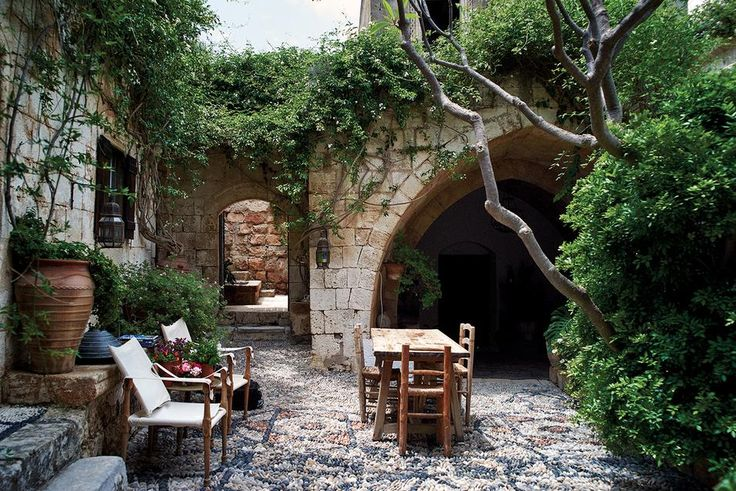 On the Greek island of Rhodes, Jasper Conran (son of Terence Conran and chairman of Conran Holdings) has transformed a pair of ancient sea captains' dwellings into a halcyon retreat. Jasmine engulfs the 16th-century courtyard.