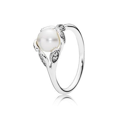 The dazzling ring design perfectly highlights the classic appeal of the white cultured pearl. Appearing as if lit from within and combined with leafy details, it melds contemporary trends with timeless elegance. #PANDORA #PANDORAring