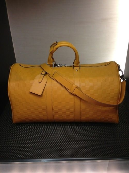 Yellow Louis Vuitton duffle bag