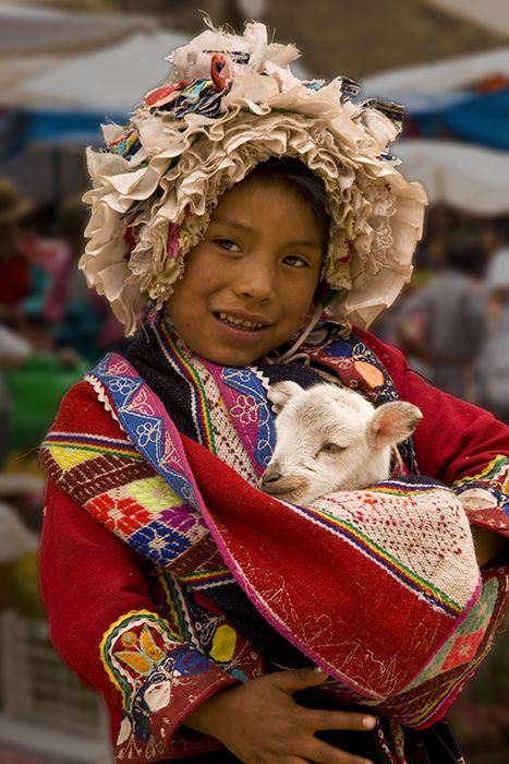 Young Peruvian girl with lamb