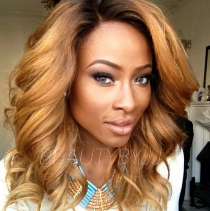 Love love love her hair...I want to get a weave like this and with these colors