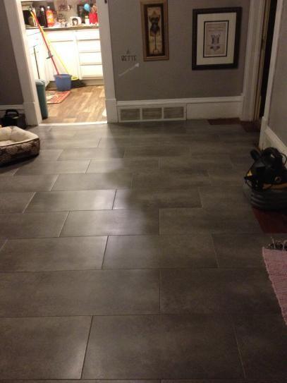 Trafficmaster ceramica 12 in x 24 in coastal grey vinyl for Trafficmaster laminate flooring