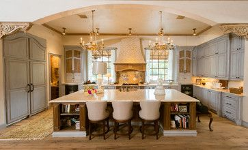 ooh good idea for cabinetry cabs can extend down to counter top to conceal coffee maker/toaster oven etc.. Also like the fabric panel for country feel French Provincial Kitchen - Mediterranean - Kitchen - Houston - Jonathan Ivy Productions
