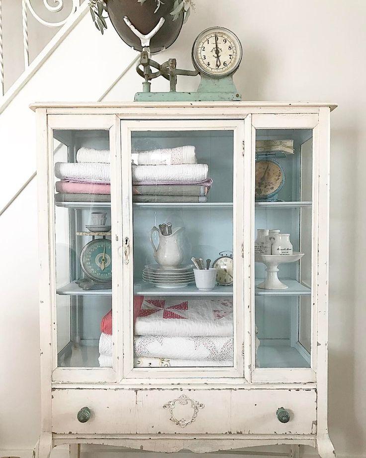 Sharing my cupboard shelves for #vivalavignettetuesday. #stylingshelves #allthingsvintage #frenchcupboard #frenchironstone #vintagescales #vintagequilts