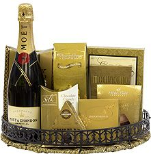 Moët & Chandon Champagne Gift Basket: A wicker and metal tray with a bottle of Moët & Chandon Champagne, assorted chocolate, truffles, biscotti and cookies, $175.00