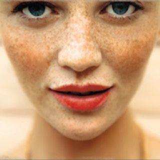 Orange lipstick.