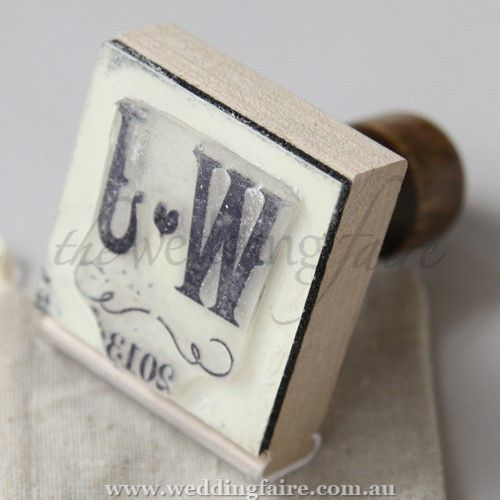 Personalised Vineyard Rubber Stamp - The Wedding Faire  Design your own personalised stamp to use on everything from your wedding invitations to your favour bags.  This stamp's surface is made of rubber with a wooden handle.  The stamp design face is 2 inches x 2 inches.  Product Material:Rubber (stamp pad) and wood (handle)  5.1 cm W x 6 cm D x 7.3 cm H