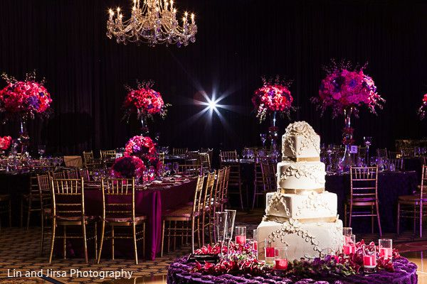 This lavish Indian wedding reception is a gorgeous red rose affair.