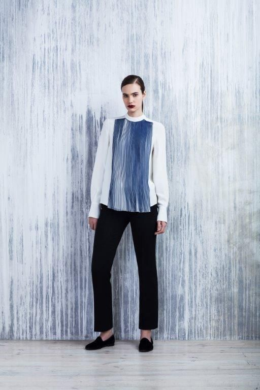 LUBLU Kira Plastinina FW14/15 white blouse with blue accordion layering and black ankle length pants.