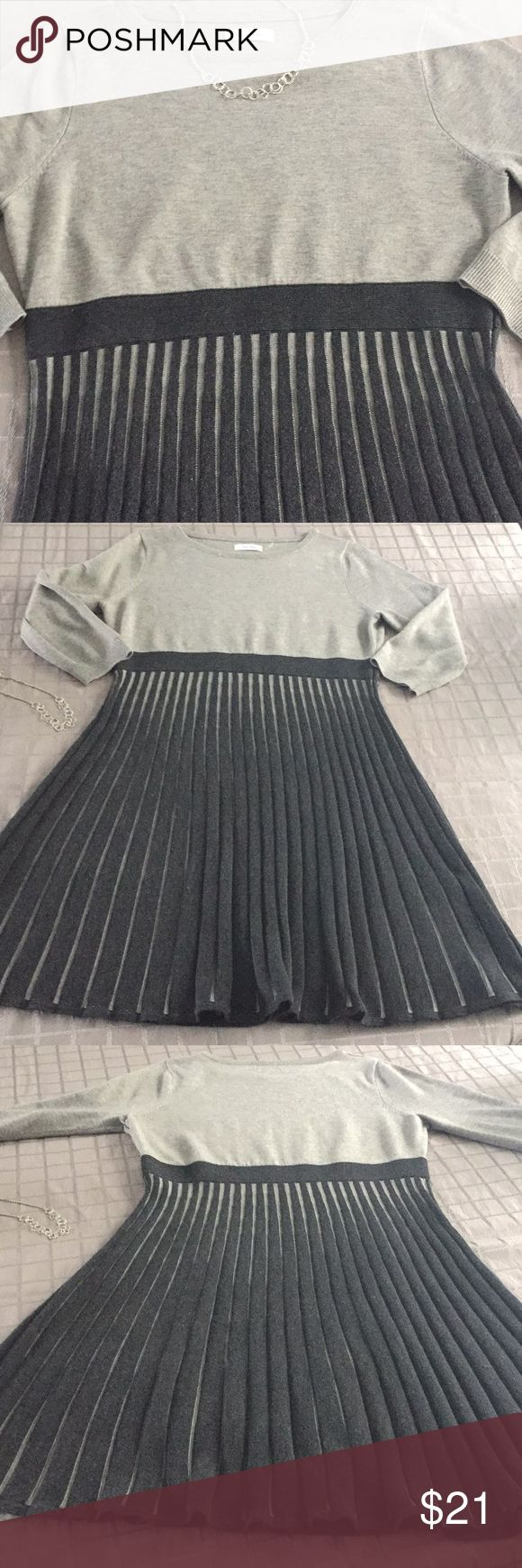 Calvin Klein light gray/dark gray sweater dress Excellent used condition ladies large Calvin Klein sweater dress- light gray bodice with dark gray skirt with light gray between the pleats of the skirt, knee length Calvin Klein Dresses Midi