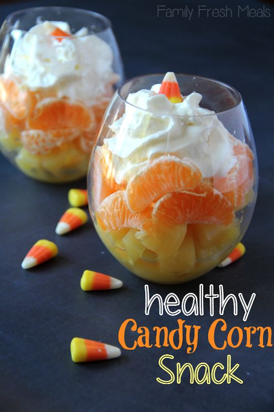 Stack pineapple, orange slices, and whipped cream or yogurt to create a healthier take on candy corn.