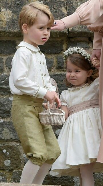 Prince George and Princess Charlotte at the wedding of Pippa Middleton and James Matthews. May 20 2017.