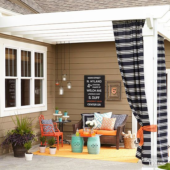 Even the simplest concrete slab can be a pretty design element with the right patio ideas. This little nook gets a big aesthetic boost thanks to a simply styled but elegantly detailed pergola. The structure abuts the house at the roofline for a seamless connection, with classically detailed columns that delineate the space's border (and provide a handy spot for some soft fabric shades, too).