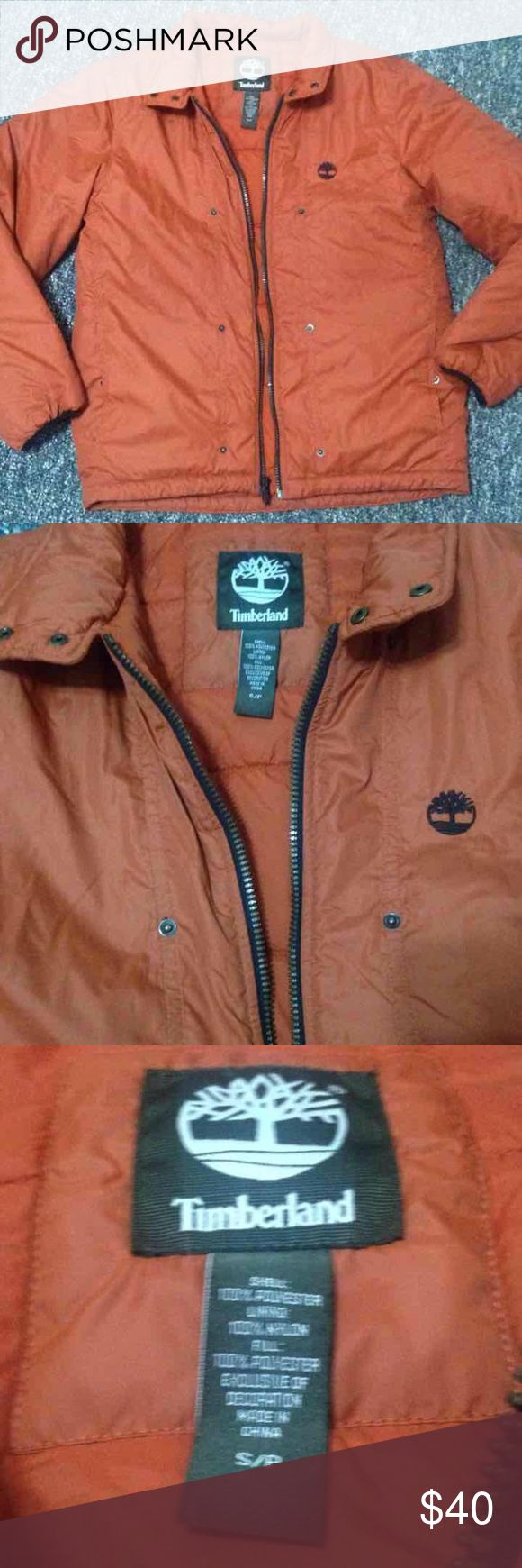"Timberland Jacket Can be worn Womans or Mens. New without tags. Adjustable waist. Measurements 27.5"" top shoulder seam to bottom 23"" across side to side (46"" round) 21"" sleeve pit to wrist Says size small but fits: Fits woman's large to xl  Fits Men's small to medium Timberland Jackets & Coats Puffers"