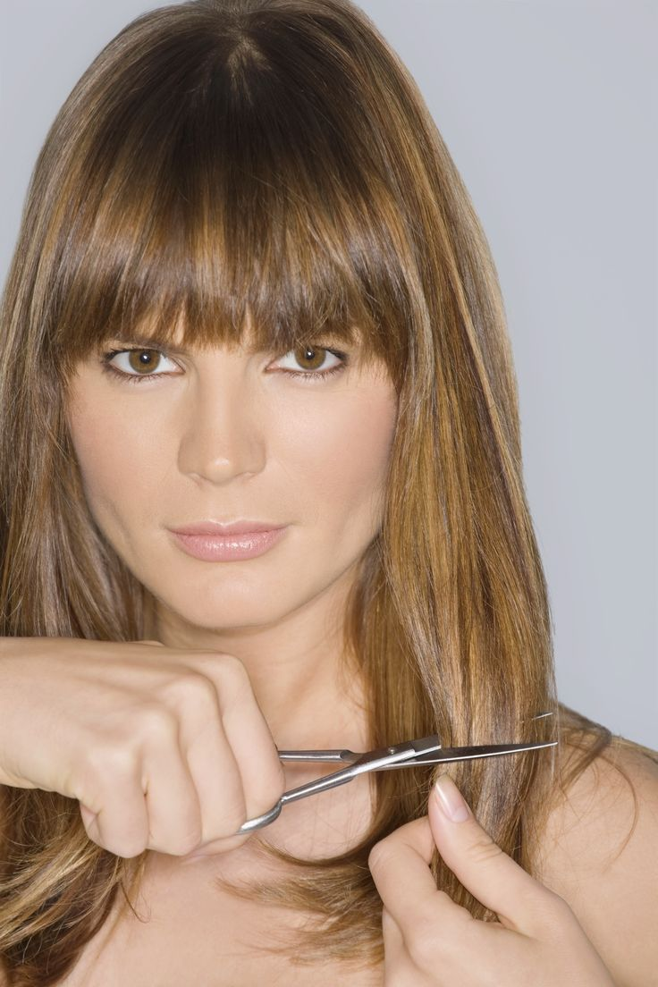 """Find the Best Bangs for Your Face Shape: """"Round face: Bangs that are a little shorter in the middle give length to a round face making it appear more oval. Bangs can be airy and wispy so they show more forehead, which will also add length. An asymmetric bang is great too because it diverts the eye."""""""