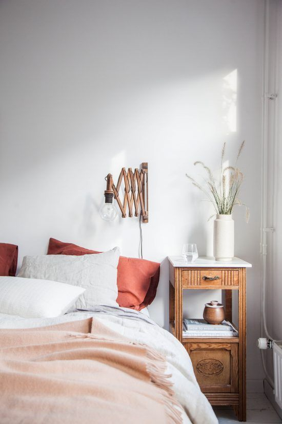 peach bedding in a white bedroom