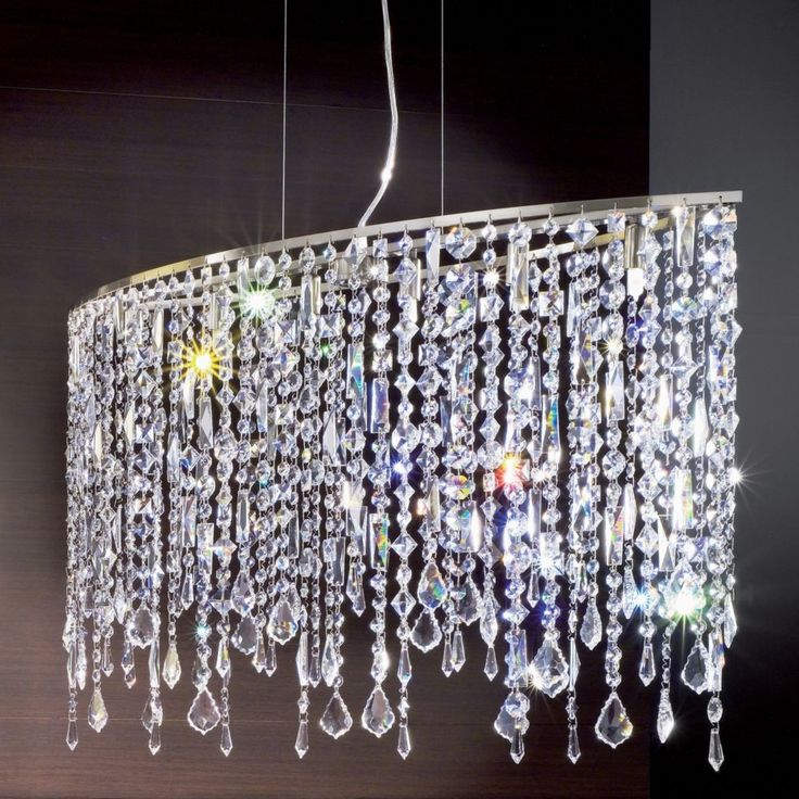 From axo light comes the marylin 100 suspension light featuring a curtain of lead crystal strands diffuses and refracts the light