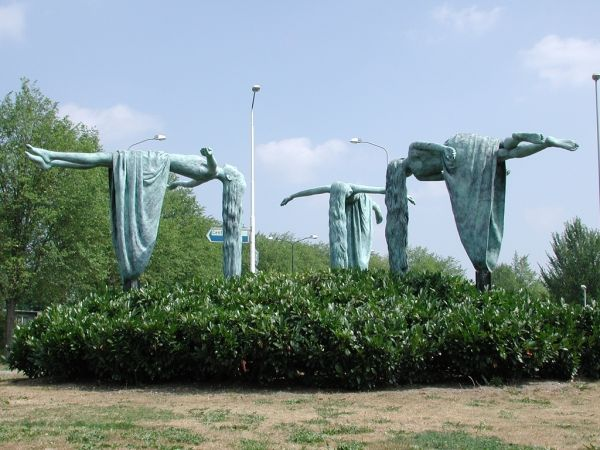 The Virgins of Apeldoorn is a public installation in the Netherlands by Dutch artist Elisabet Stienstra. The sculptural work features three bronze statues of girls in varying positions, all seeming to lie parallel to the ground.