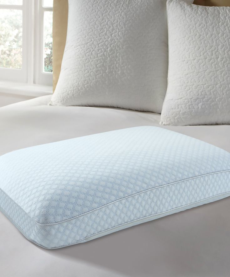 Ensure proper support during a restful night's sleep or a quick snooze with this snuggly pillow. Its cooling construction helps regulate heat buildup for a more optimal sleeping temperature range. Cover: 100% viscose rayonFace and inner: 100% polyesterMemory foam: 100% polyurethaneCover: machine wash; tumble dryImported