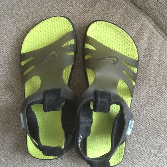 Nike water shoes SZ 4 Nike water shoes. Slip on, worn once, neon green shoe bed, SZ 4. Super cute and very comfortable! My daughter grew out of these too quickly to use more than once! Nike Shoes Athletic Shoes