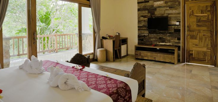 Ubud Accommodation :: Sri Ratih Cottages Suite Room pricey at 150 on discount