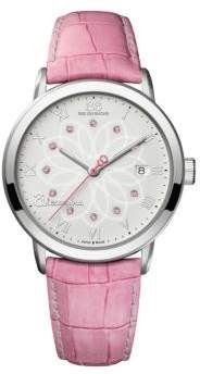 Buy Now  Ladies Alexandra Double 8 Origin Quartz Watch;Inspired by and dedicated to the short courageous life of cancer fighter Alexandra this 88 Rue du Rhone watch supports Courir Ensemble the non-profit foundation that championed Alexandra's fight. A round stainless steel bezel displays a charming filigree flower print dial adorned with Roman numeral markers eleven pink sapphire crystals date display and a coral 8-shaped counterweight. Housing Quartz movements this Swiss-made watch is…