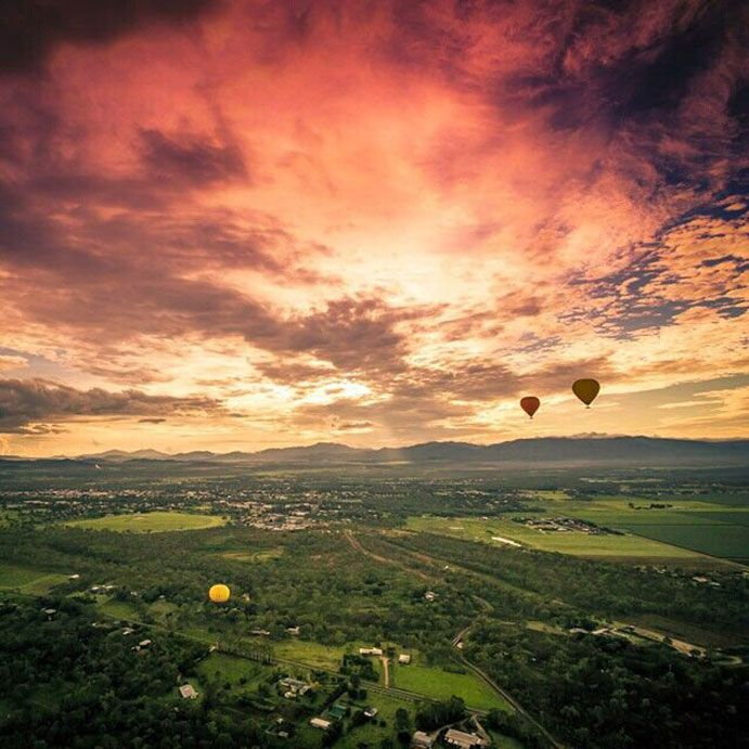 There's nothing quite like watching the sunrise as you glide over the valleys and farmlands of the Atherton Tablelands #thisisqueensland
