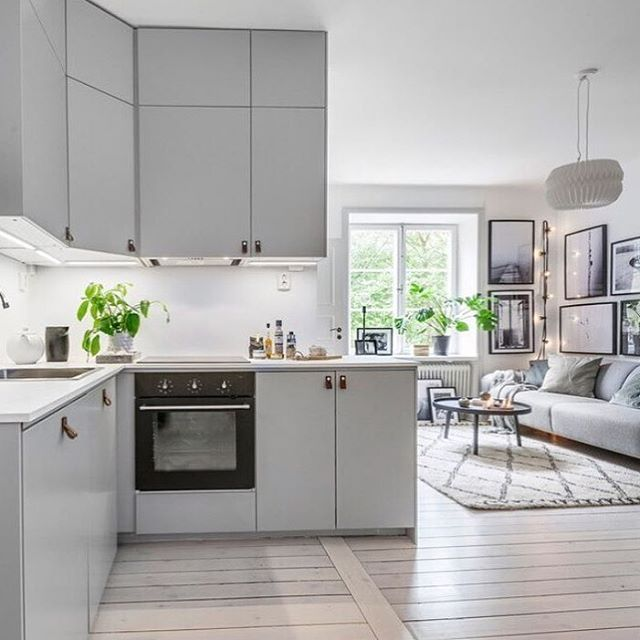 Awesome kitchen and photo art from Johanna Lehtinen on the wall. Home for sale via @bosthlm_realestate styled by cool @scandinavianhomes✌️ #theposterclub #byjohannalehtinen #photoart #livingroom #interiordesign #kitchen #posters #gallerywall