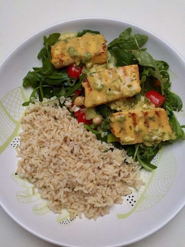 Grilled lemon basil tofu over vegetables with a side of