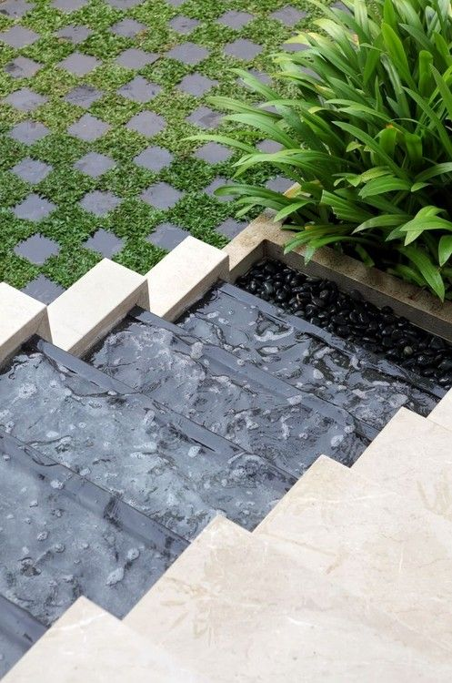Water feature as steps at the side of the steps. #landscaping #waterfeature #steps:
