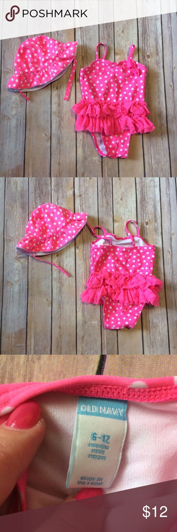 Old Navy Swimsuit & Hat Neon pink & white polka dot swimsuit and matching sun hat. Love the tulle tutu around the waist and the bows on the neckline. Swimsuit is labeled sz 6-12m & hat is labeled 3-6m, but were worn as a set. Hat is lined with terry cloth. EUC. 111708 Old Navy Swim One Piece
