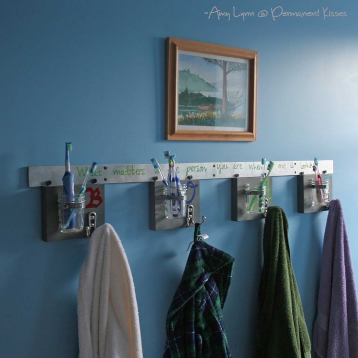 Separate toothbrush holder and towel hook for each child in a shared bathroom - great idea!