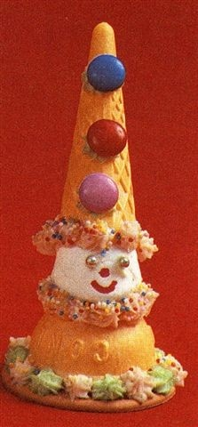 don't particularly like this . . . could make a clown with one scoop ice cream on plate and cone for hat  : -)