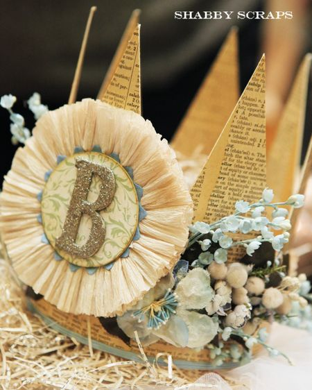 Love the crepe paper flower with the glass glitter monogram!