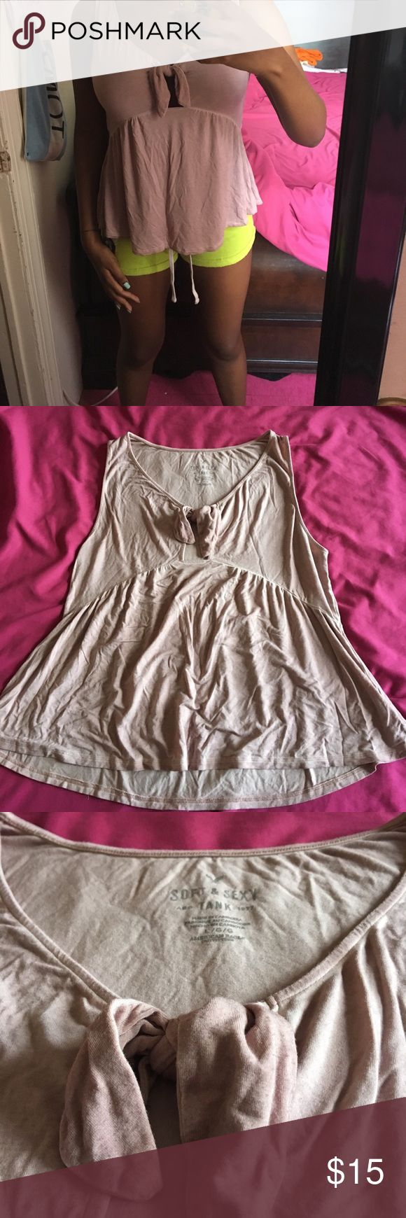 Dusty Mauve American Eagle Outfitters Bowtie Tank Brand new never worn American eagle bowtie tank top. A light mauve color . Was taken in natural light so it looks a lot lighter. In great condition! American Eagle Outfitters Tops Tank Tops