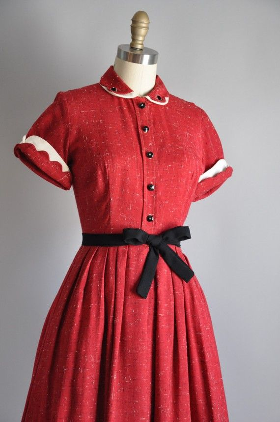 1950s sassy red full skirt dress. I really like full-skirted vintage dresses that manage to avoid seeming too fancy or too twee or somehow just too much. This is darling.