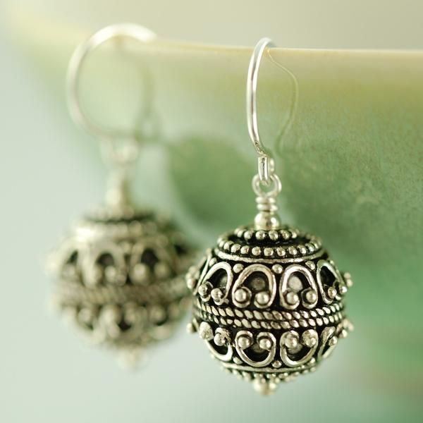 Bali style earrings featuring round textured dangle with an antiqued blackened finish. These light weight beads dangle freely form sterling silver earwires. https://southpawonline.com/collections/sterling-silver-bali-collection