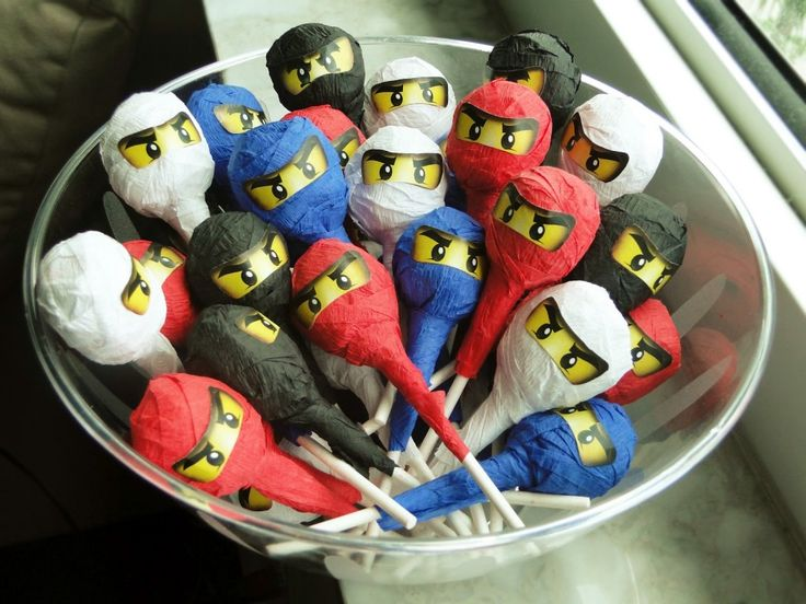 Ninjago Lollipops: UseTootsie pops: cover them with crepe paper and then stuck on the ninja eyes printed out on sticker paper. Use some double-sided tape.