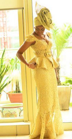 The award-winning designer shines in one of her designs. Stunning!