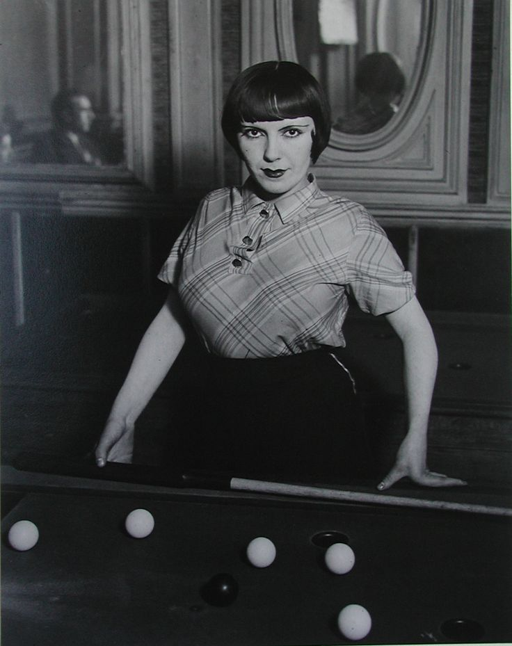 Girl playing snooker - copyright George Brassai