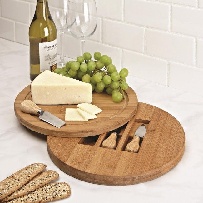 Serve your guests with this elegant bamboo cheese board. Swivel top reveals storage compartment for three cheese knives (included).  The three assorted tools feature stainless steel cutting blades.