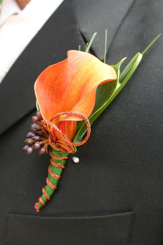 A single calla lily in this funky color is a great way to add a pop of color to your groom.